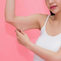 woman pinching skin on her arm